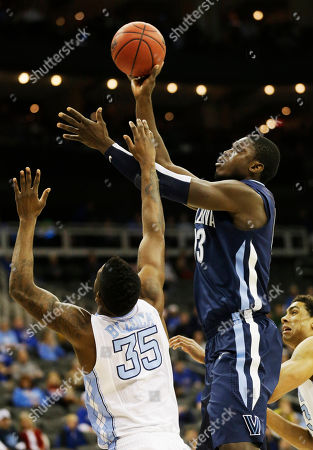 Mouphtaou Yarou, Reggie Bullock Villanova forward Mouphtaou Yarou (13) shoots over North Carolina guard/forward Reggie Bullock (35) during the first half of a second-round game in the NCAA college basketball tournament at the Sprint Center in Kansas City, Mo