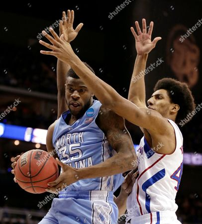 Reggie Bullock North Carolina guard Reggie Bullock (35) is pressured by Kansas forward Kevin Young (40) during the first half of a third-round game in the NCAA college basketball tournament, in Kansas City, Mo