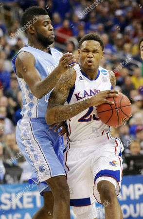 Ben McLemore, Reggie Bullock Kansas guard Ben McLemore (23) drives on North Carolina guard/forward Reggie Bullock (35) during the first half of a third-round game in the NCAA college basketball tournament at the Sprint Center in Kansas City, Mo