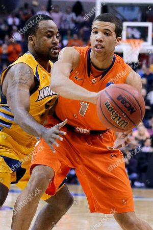 Michael Carter-Williams, Junior Cadougan Syracuse guard Michael Carter-Williams (1) passes around Marquette guard Junior Cadougan during the first half of the East Regional final in the NCAA men's college basketball tournament, in Washington
