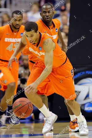 Michael Carter-Williams Syracuse guard Michael Carter-Williams (1) heads down court with the ball during the first half of the East Regional final in the NCAA men's college basketball tournament, in Washington