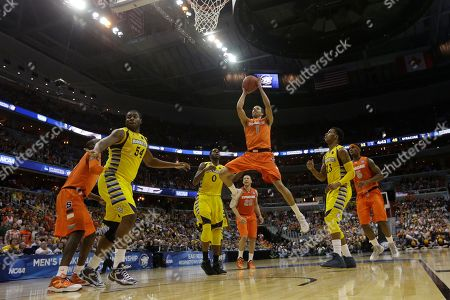 Michael Carter-Williams Syracuse guard Michael Carter-Williams (1) heads toward the basket during the second half of the East Regional final in the NCAA men's college basketball tournament, in Washington