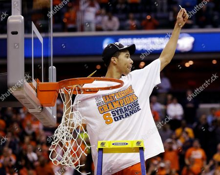 Michael Carter-Williams Syracuse guard Michael Carter-Williams (1) celebrates after cutting down the net following their 55-39 win over Marquette in the East Regional final in the NCAA men's college basketball tournament, in Washington