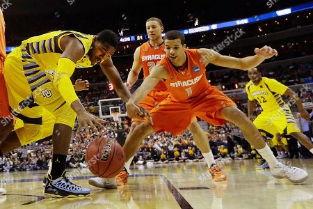 Steve Taylor, Jr., ichael Carter-Williams Marquette forward Steve Taylor Jr., (25) and Syracuse guard Michael Carter-Williams (1) reach for a loose ball during the first half of the East Regional final in the NCAA men's college basketball tournament, in Washington
