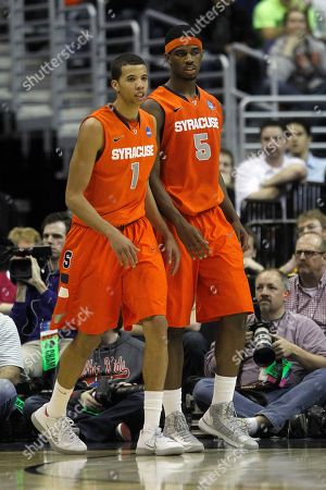 Michael Carter-Williams, C.J. Fair Syracuse guard Michael Carter-Williams (1) and Syracuse forward C.J. Fair (5) walk across the court during the second half of the East Regional final in the NCAA men's college basketball tournament, in Washington