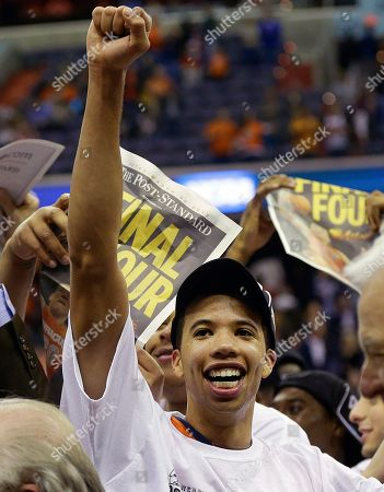 Syracuse guard Michael Carter-Williams celebrates after their 55-39 win over Marquette in the East Regional final in the NCAA men's college basketball tournament, in Washington