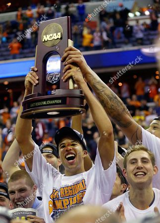 Michael Carter-Williams Syracuse guard Michael Carter-Williams holds up the trophy following their 55-39 win over Marquette in the East Regional final in the NCAA men's college basketball tournament, in Washington