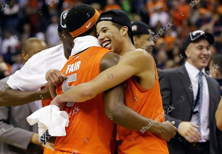 Michael Carter-Williams, C.J. Fair Syracuse guard Michael Carter-Williams (1) hugs forward C.J. Fair (5) after their 55-39 win over Marquette in the East Regional final of the NCAA men's college basketball tournament, in Washington