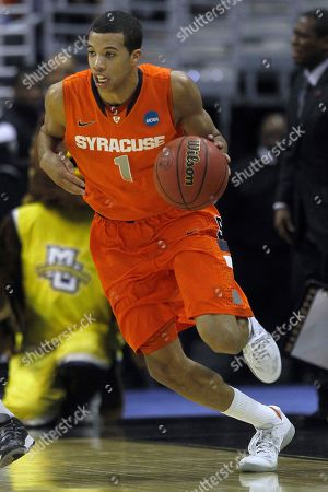 Michael Carter-Williams Syracuse guard Michael Carter-Williams (1) drives the ball during the second half of the East Regional final in the NCAA men's college basketball tournament, in Washington