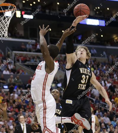 Shannon Scott, Ron Baker Ohio State guard Shannon Scott left, and Wichita State's Ron Baker battle under the basket during the first half of a West Regional final in the NCAA college basketball tournament, in Los Angeles