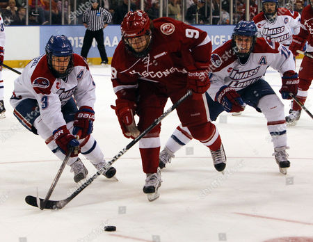UMass-Lowell's Chad Ruhwedel, 3, and Josh Holmstrom catch up with Wisconsin's Mark Zengerle during the first period of an NCAA regional semifinal hockey game in Manchester, N.H