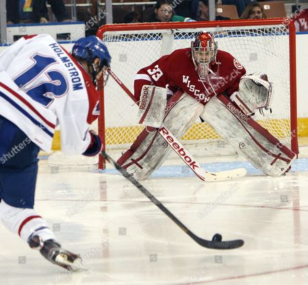 Joel Rumpel Wisconsin goaltender Joel Rumpel, right, gets ready for a shot from UMass-Lowell's Josh Holmstrom during the second period of the NCAA regional semifinal hockey game in Manchester, N.H