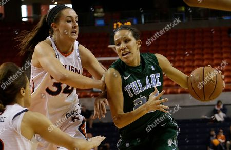 Tulane forward Tiffany Dale (22) drives the lane as Auburn center Peyton Davis (34) defends during the first half of an NIT tournament basketball game in Auburn, Ala