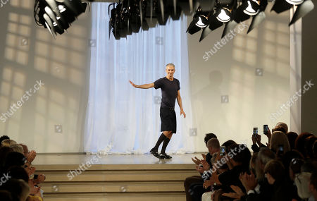 Fashion designer Rodolfo Paglialunga acknowledges the applause of the audience after presenting the Jil Sander women's Spring-Summer 2017 collection, part of the Milan Fashion Week, unveiled in Milan, Italy