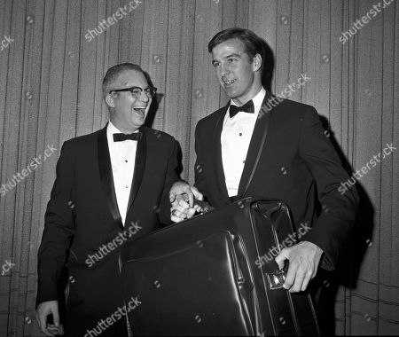Associated Press sports writer Dave O'Hara, left, presents a travelling bag to Boston Red Sox pitcher Jim Lonborg after he was named American League Pitcher of the Year at a Boston Baseball Writers dinner in Boston. O'Hara, who covered Boston sports greats from Ted Williams to Larry Bird during a 50-year career with The Associated Press, died at his home in Winter Haven, Fla., his daughter, Debbie O'Hara-Rusckowski said. He was 86