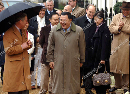 Prince Charles and Bruno Wu of Sun Media from Shanghai share a joke. Prince Charles was working on his Birthday taking visitors around the village, which was designed specifically for him by the architect Leon Krier