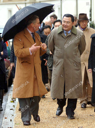 Prince Charles and Bruno Wu of Sun Media from Shanghai. Prince Charles was working on his Birthday taking visitors around the village, which was designed specifically for him by the architect Leon Krier