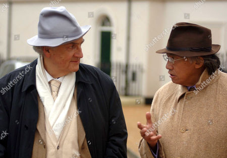 Leon Krier, architect left talking with Chinese entrepreneur David Tang. The village was designed specifically for Prince Charles by the by architect Leon Krier