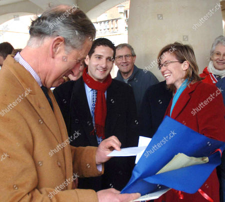 Prince Charles was working on his Birthday taking visitors around the village, which was designed specifically for him by the architect Leon Krier. Journalist Lesley Richardson presented a card to him from all the reporters and photographers covering the visit