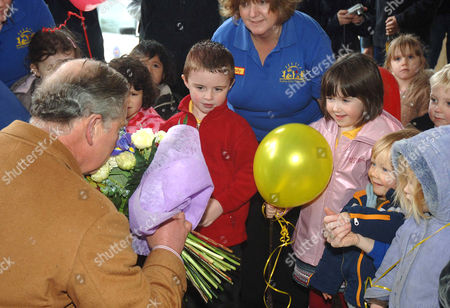 Prince Charles was working on his Birthday taking visitors around the village, which was designed specifically for him by the architect Leon Krier. Here children from Sunnydays Nursery gave him a card and flowers