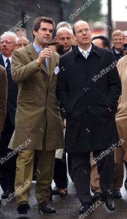 Prince Albert of Monaco. He was taken on a tour of the village, which was designed specifically for Prince Charles by the by architect Leon Krier