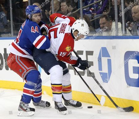 Steve Eminger, Drew Shore New York Rangers' Steve Eminger (44) and Florida Panthers' Drew Shore (15) battle for the puck during the first period of the NHL hockey game at Madison Square Garden in New York. The Rangers won 6-1