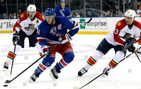 Ryan Callahan, Tomas Kopecky, Mike Weaver New York Rangers' Ryan Callahan (24) skates past Florida Panthers' Tomas Kopecky, (82) of the Czech Republic, and Mike Weaver (43) during the second period of an NHL hockey game at Madison Square Garden in New York