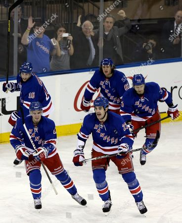 John Moore (17), Derick Brassard, Brian Boyle, Steve Eminger (44 New York Rangers' John Moore, front left, smiles after celebrating a goal with teammates Brian Boyle (22), Derick Brassard (16), Carl Hagelin (62) and Steve Eminger, right, during the third period of an NHL hockey game against the Pittsburgh Penguins, in New York. The Rangers won 6-1