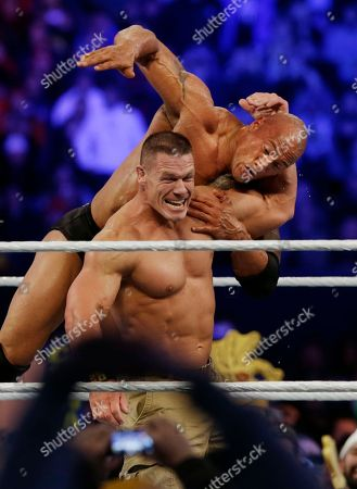 """John Cena, Dwayne Douglas Johnson John Cena, left, wrestles with Dwayne Johnson, known as The Rock during Wrestlemania in East Rutherford, N.J. Johnson said he won't rule out a return to the ring that made him famous. """"I'd like to leave it open. But if I'd never wrestle again, I'd be very content with that,"""" Johnson said recently while on set filming the season finale of TNT's """"The Hero"""