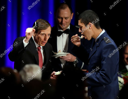 David H. Petraeus David H. Petraeus, former army general and head of the Central Intelligence Agency, tastes a ceremonial cake presented to him by Hector Sandoval, a member of the USC ROTC program, at the annual dinner for veterans and ROTC students at the Univeristy of Southern California, in downtown Los Angeles . It marked Petraeus' first public remarks since he retired as head of the CIA after an extramarital affair scandal
