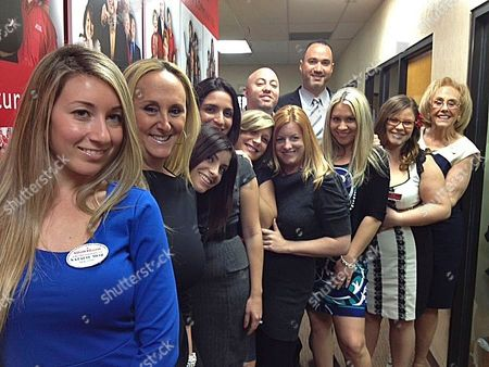 Real estate agents who won $1 million in the Powerball pose for a photograph, in Plantation, Fla. he twelve realtors at Keller Williams Partners Realty in Plantation joined the office pool for the March 23 Powerball drawing, pitching in $20 each