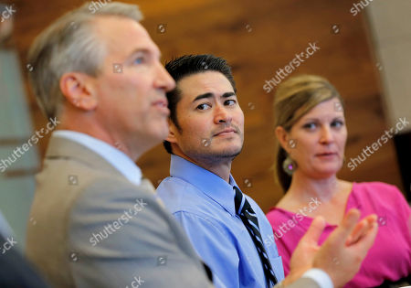 Stock Photo of Thomas Beatie, Amber Nicholas, David Michael Cantor Thomas Beatie, center, and his girlfriend Amber Nicholas, listen as attorney David Michael Cantor speaks, in Phoenix. Maricopa County Family Court Judge Douglas Gerlach ruled, March 29, 2013, that Arizona's ban on same-sex marriages prevents Thomas Beatie's 9-year union from being recognized as valid. Beatie was born a woman and later underwent a double-mastectomy, and began testosterone hormone therapy and psychological treatment to become a man, but he retained female reproductive organs and gave birth to three children. Gerlach said he had no jurisdiction to approve a divorce because there's insufficient evidence that Beatie was a man when he married Nancy Beatie in Hawaii