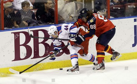 Stock Image of MUELLER New York Rangers' Steve Eminger (44) and Florida Panthers' Peter Mueller (88) battle for the puck during the second period of an NHL hockey game in Sunrise, Fla
