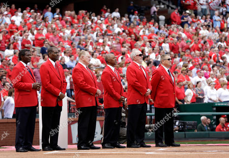 Red Schoendienst, Lou Brock, Bob Gibson, Bruce Sutter, Whitey Herzog St. Louis Cardinals greats from left to right, Lou Brock, Bob Gibson, Red Schoendienst, Ozzie Smith, Bruce Sutter and Whitey Herzog watch a video during a ceremony honoring former St. Louis Cardinals great Stan Musial before the start of a baseball game between the St. Louis Cardinals and the Cincinnati Reds, in St. Louis. Musial died January 19, 2013 at the age of 92