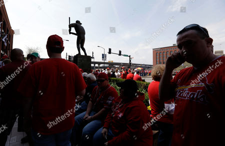 Stan Musial Fans wait to enter Busch Stadium near a statue of former St. Louis Cardinals great Stan Musial before the start of a baseball game between the St. Louis Cardinals and the Cincinnati Reds, in St. Louis