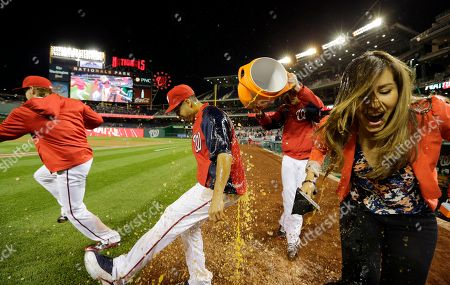 Gio Gonzalez, Julie Alexandria Washington Nationals starting pitcher Gio Gonzalez, left, and MASN's sideline reporter Julie Alexandria, right, react as they get a dunking of Gatorade after a baseball game at Nationals Park, in Washington. The Nationals won 8-1