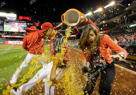 Gio Gonzalez, Julie Alexandria Washington Nationals starting pitcher Gio Gonzalez, second from left, and MASN's sideline reporter Julie Alexandria react as they get a dunking of Gatorade after a baseball game at Nationals Park, in Washington. The Nationals won 8-1