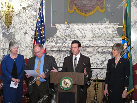 Republican Sen. Andy Hill, second from right, speaks about the chamber's budget proposal, joined by Democratic Sens. Sharon Nelson and Jim Hargrove, left, and Republican Sen. Linda Evans Parlette, right,, in Olympia, Wash. The proposal seeks to address a projected budget deficit and put more money into the state's basic education system without new taxes