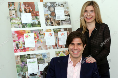 Stock Image of Alexa Hirschfeld, right, and James Hirschfeld smile as they pose for a photo at their office in New York. Paperless Post has defied its original digital business model successfully once. Now the online invitation and greeting card startup is taking that defiance a step further. The New Yaork company launched PAPER by Paperless Post in October after customers requested a way to get its electronic greeting cards and invitations in a more old-fashioned way: On actual paper. Now Paperless Post is teaming up with stationery