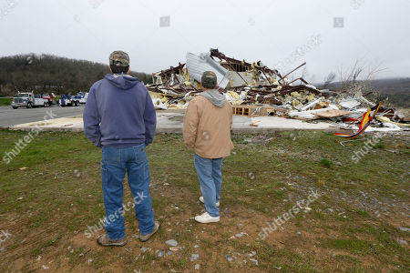 Larry Gammill, left, and Tim Parks survey tornado damage at Botkinburg Foursquare Church in Botkinburg, Ark., after a severe storm struck the building late Wednesday. The National Weather Service is surveying areas Thursday to determine whether tornadoes or strong winds caused damage