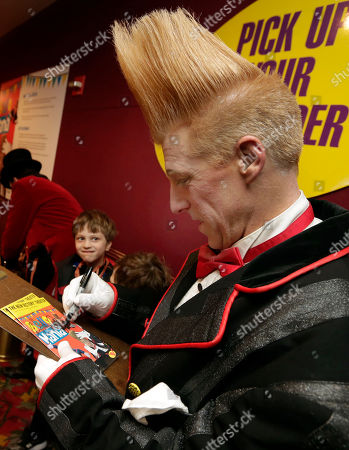 """Bello Nock This photo shows performer Bello Nock signing autographs in the lobby of the New Victory Theater, after his """"Bello Mania"""" show, in New York. Nock, a seventh-generation circus performer, is never offstage during the 90-minute performance, which combines slapstick clowning with death-defying aerial stunts. He performs through March 31 at the New Victory before moving on to the Canadian side of Niagara Falls and then a 10-week stint at the Beau Rivage Casino in Biloxi, Miss"""