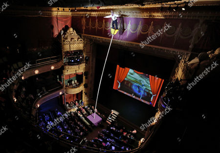 """Bello Nock This photo shows performer Bello Nock perched atop a sway pole trying to retrieve an balloon, as he performs during his """"Bello Mania"""" show, at the New Victory Theater in New York. Nock, a seventh-generation circus performer, is never offstage during the 90-minute performance, which combines slapstick clowning with death-defying aerial stunts. He performs through March 31 at the New Victory before moving on to the Canadian side of Niagara Falls and then a 10-week stint at the Beau Rivage Casino in Biloxi, Miss"""