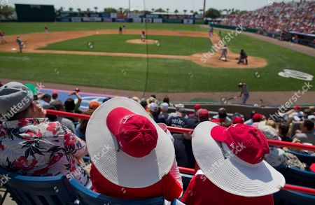 Washington Nationals fans Edwina Meade, of Edgewater, Fla., right, and Bette Davis, of Charlottesville, Va., protect themselves from the sun during an exhibition spring training baseball game against the Detroit Tigers, in Viera, Fla