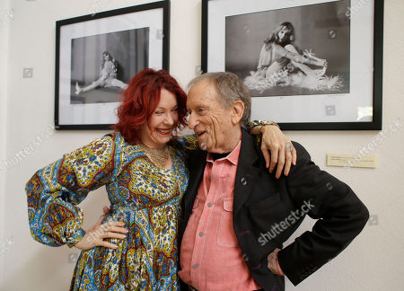 "Baron Wolman, Pamela Des Barres Former Rolling Stone photographer Baron Wolman, right, embraces Pamela Des Barres, left, the subject in both photographs on the wall behind during the opening of Wolman's photo exhibit ""The Groupies"" at Markham Vineyards in St. Helena, Calif. More than 75 wineries have art on display all year long"