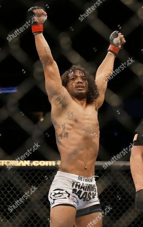 Benson Henderson Benson Henderson raises his arms after the final round of a UFC lightweight championship mixed martial arts fight against Gilbert Melendez in San Jose, Calif., . Henderson won by split decision to retain the championship