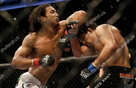 Benson Henderson, Gilbert Melendez Benson Henderson, left, throws an elbow at Gilbert Melendez during the fourth round of a UFC lightweight championship mixed martial arts fight in San Jose, Calif., . Henderson won by split decision to retain the championship