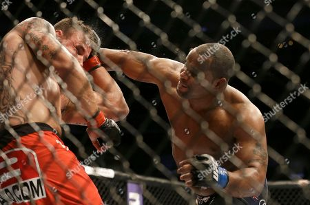 Daniel Cormier, Frank Mir Daniel Cormier, right, punches Frank Mir during the third round of a UFC heavyweight mixed martial arts fight in San Jose, Calif., . Cormier won by unanimous decision