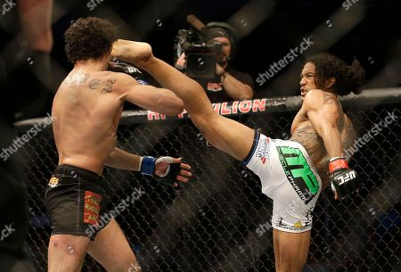 Benson Henderson, Gilbert Melendez Benson Henderson, right, kicks Gilbert Melendez during the second round of a UFC lightweight championship mixed martial arts fight in San Jose, Calif., . Henderson won by split decision to retain the championship