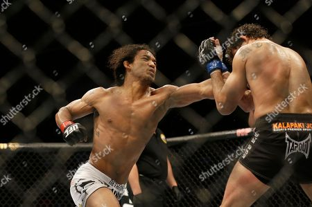 Benson Henderson, Gilbert Melendez Benson Henderson, left, punches Gilbert Melendez during the third round of a UFC lightweight championship mixed martial arts fight in San Jose, Calif., . Henderson won by split decision to retain the championship