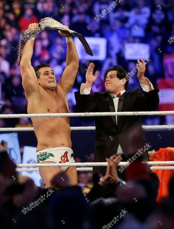 """Jose Alberto Rodríguez, Ricardo Rodriguez Jose Alberto Rodríguez, of Mexico, known as Alberto Del Rio stands with his manager, Ricardo Rodriguez, right, as he holds up a championship belt after defeating Jacob """"Jake"""" Hager, Jr., known as Jack Swagger, in East Rutherford, N.J., during the WWE Wrestlemania 29 event"""